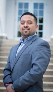 Joseph Shook represents Latinos in Miami when discriminated against.